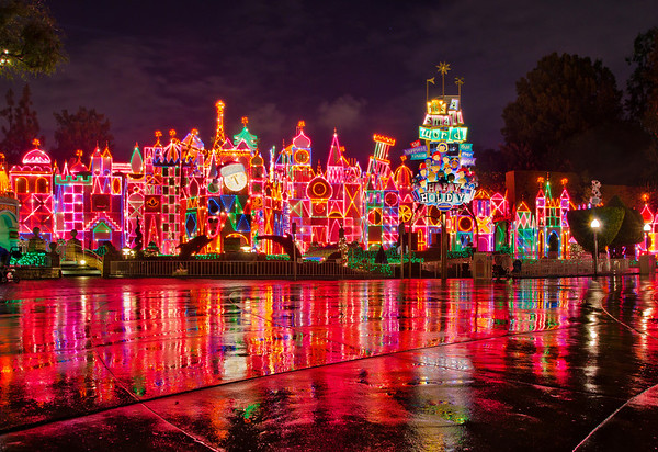 Disneyland Resort Disneyland (park) Fantasyland 'it's a small world' holiday  The facade of 'it's a small world' holiday on an empty night after rain. Even though it may leave guests a little soggy, rain really is great for Disney photography, don't you think?  For more 'it's a small world' holiday, check out this page, which includes my video of the attraction! http://www.disneytouristblog.com/its-a-small-world-holiday-photos-video-review/