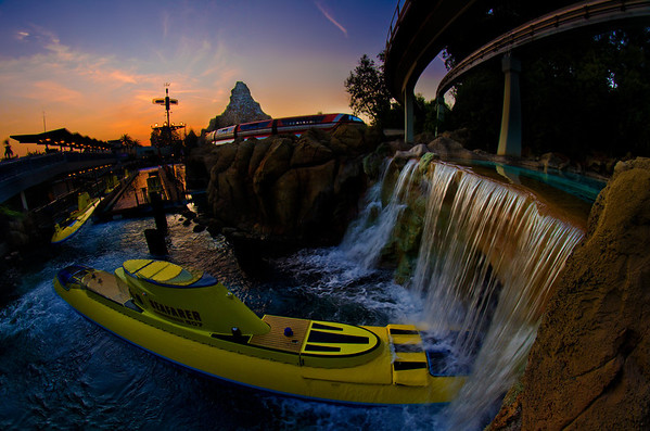The Finding Nemo Submarine Voyage and the Disneyland Monorail round the bend as a beautiful sunset falls over the Matterhorn.