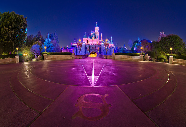 When the crowds have cleared, a Compass Rose is visible on the ground in front of Sleeping Beauty Castle at Disneyland. Photo taken with a Rokinon 8mm fisheye lens.Lens review: http://www.disneytouristblog.com/8mm-fisheye-samyang-rokinon-lens-review/