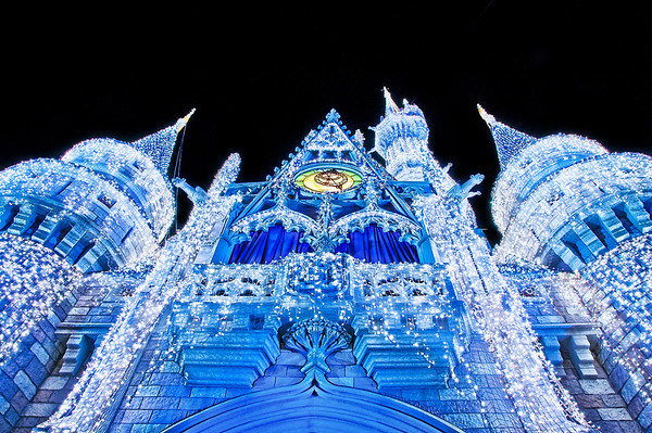 Walt Disney World Resort Magic Kingdom Christmas on Main Street, USA  Here's a photo looking up at the Dream Lights on Cinderella Castle during Christmas at Walt Disney World. Such a beautiful sight!  For more photos and information about Christmas at Walt Disney World, check out my Walt Disney World Ultimate Christmas Guide
