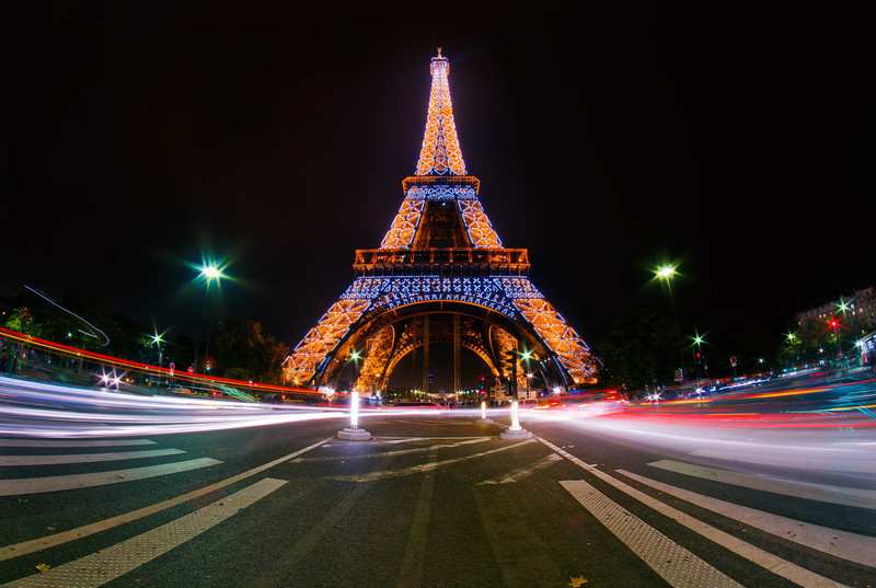 The Eiffel Tower in Paris, France during its hourly light show. Read more: https://www.travelcaffeine.com/eiffel-tower-paris-light-show-photo/