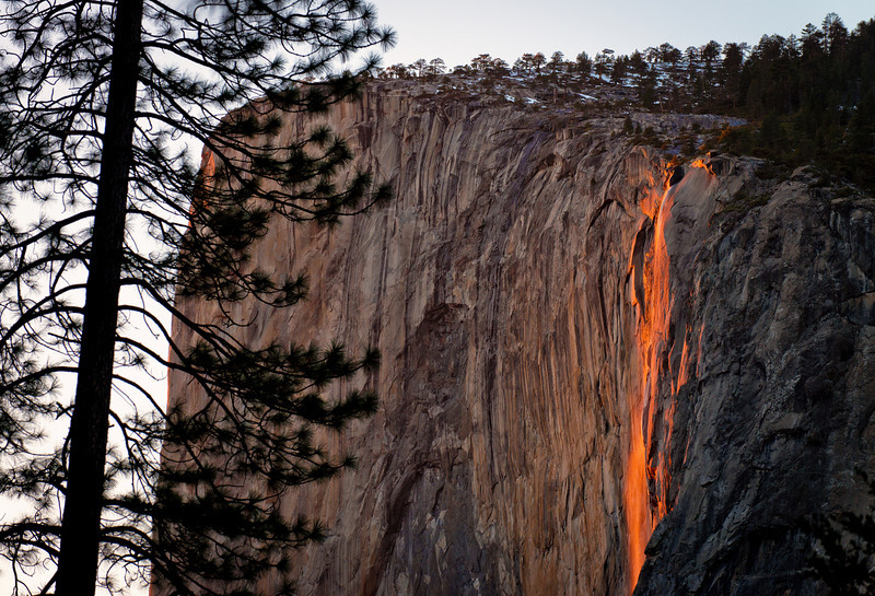 This is a photo of the Firefall at Horsetail Falls in Yosemite National Park taken in February 2013. In late February, Horsetail Falls in Yosemite National Park looks like it's on fire at the end of the sunset. This occurs due to the angle of the sunset, and would actually occur in October, too, but there's only water in this fall due to snow melt-off, and no snow is melting in October. There actually wasn't much water in it in February 2013, either, but there's just enough to make the effect work.